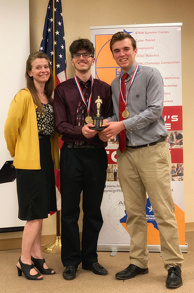 Third Place: (L-R) Teacher, Teresa Mann; and students, Joshua Macera and Wesley Appler=, Oriskany Central School.
